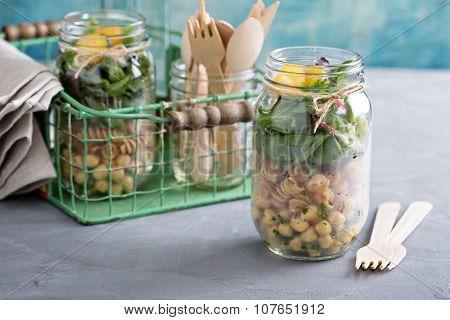 Assembling a mason jar salad