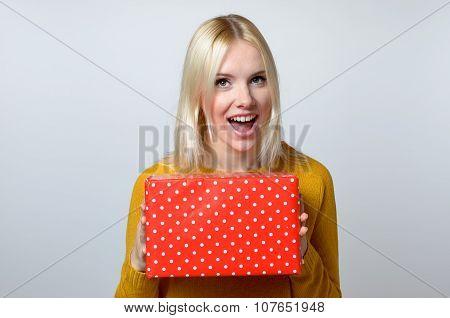 Happy Woman Holding Present