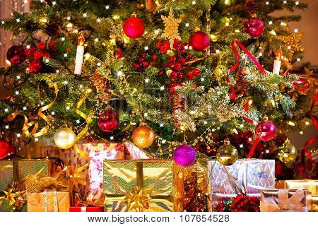Decorated Christmas tree with various gifts. Christmas and New Year celebration. Holiday Christmas scene. Christmas gifts under the Christmas tree