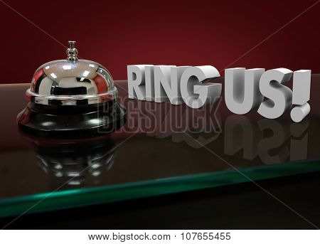 Ring Us words in 3d letters on a front desk of a hotel or service counter