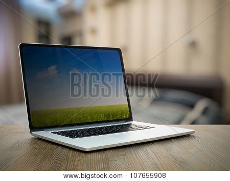 laptop on old wooden table in the bedroom