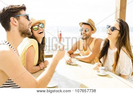 Fiends having a great time together at the beach bar