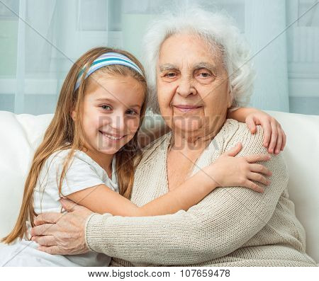 portrait of grandmother and granddaughter embracing