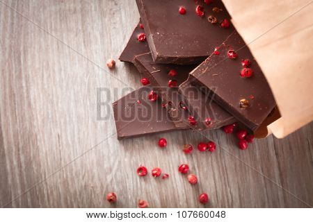 Pieces Of Dark Chocolate With Pink Pepper