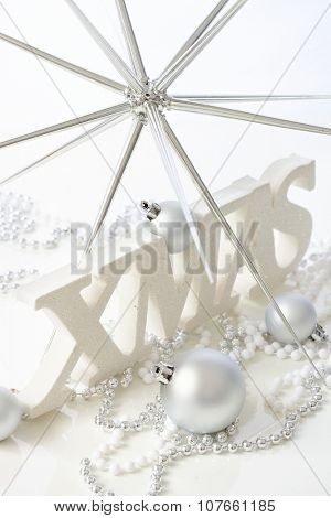 Christmas decoration in white with letters xmas.