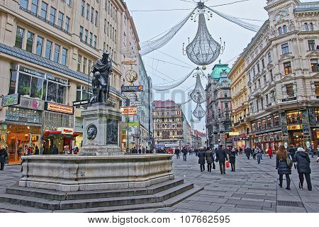 Holy Trinity Column And Graben Street Of Vienna In Austria With Christmas Decoration In The Street