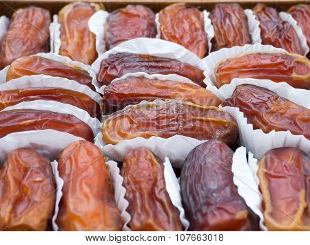 Dried Dates In The Paper Wrappings