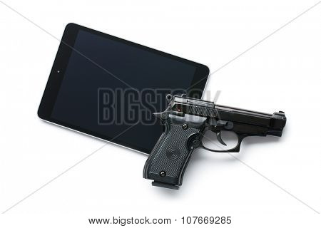 handgun and tablet on white background