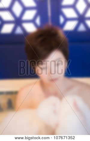 Blurred Image Of Beautiful Young Woman Takes Bubble Bath