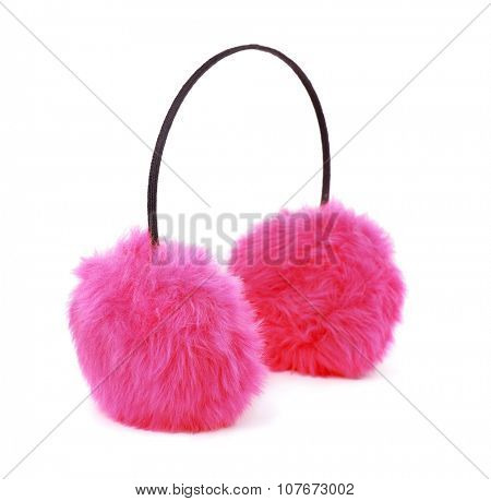 Pink winter fur earmuffs isolated on white