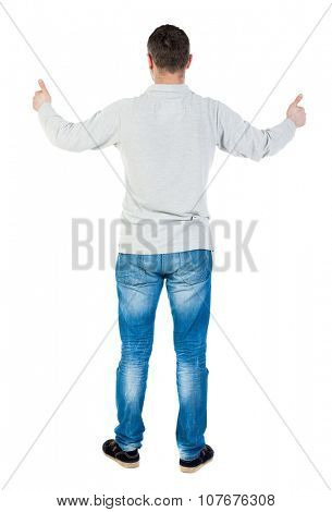 Back view of  man thumbs up. Rear view people collection. backside view of person. Isolated over white background. A guy in a gray jacket showing thumbs up with both hands.