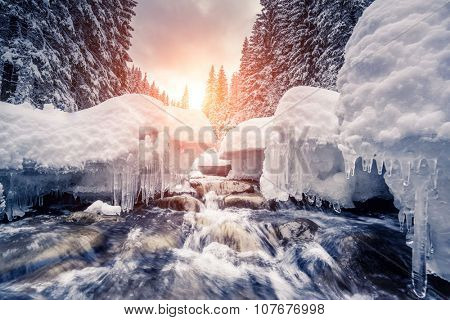 Miracle river at sunlight in the morning. Dramatic and picturesque wintry scene. Location Carpathian, Ukraine, Europe. Beauty world. Instagram toning effect. Glowing filter.