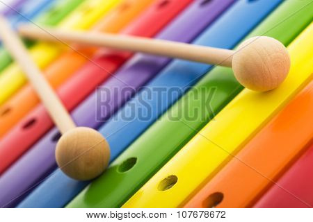 Rainbow Colored Wooden Toy Xylophone Texture Against White Background
