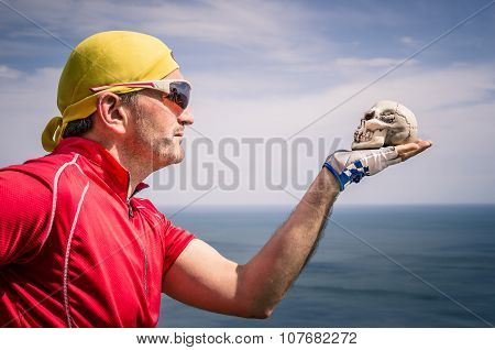 Cyclist With Bandana Headband Looking At A Skull