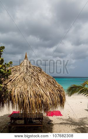 Picnic Bench And Beach Towels Under Hut