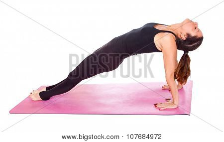 Beautiful woman doing Yoga  pose on yoga class. Studio shot.