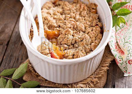 Peach crumble in a baking dish