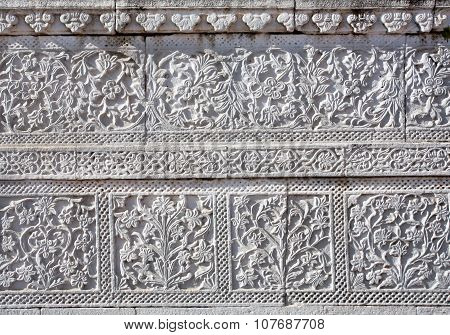 Patterns on carved walls of historical temple in India