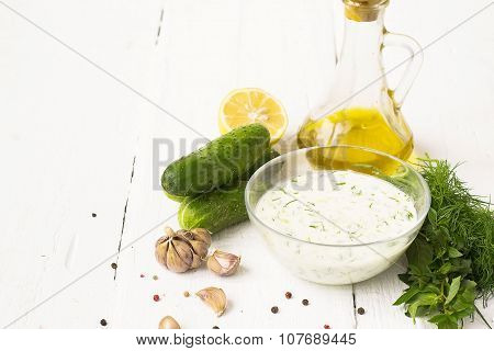 Tzatziki - Traditional Greek Sauce A Glass Plate On A White Background