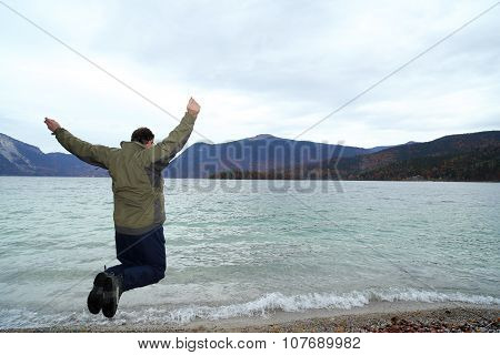 Jumping Man With Lake