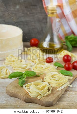 Fresh Homemade Pasta Machine Pasta, Basil,. Tomatoes On A Wooden Background