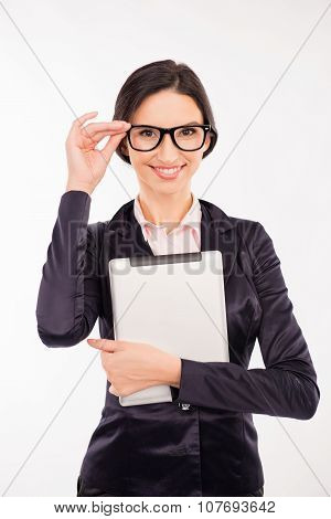 Smart Woman With Glasses In Business Clothes Holding A Tablet