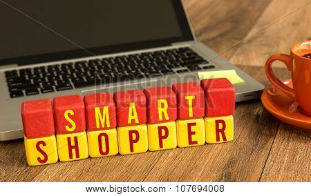 Smart Shopper written on a wooden cube in a office desk