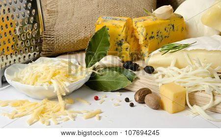 The Bowl With Grated Cheese And Spices And Cheeses Around