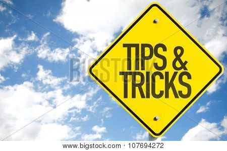 Tips & Tricks sign with sky background