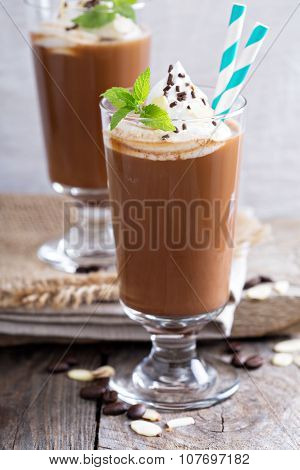 Frappuccino in a glass with cream