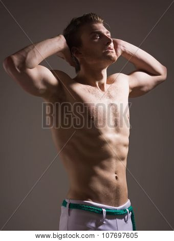 Strong Athletic Man On Dark Background