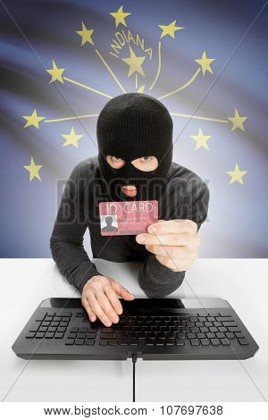 Hacker With Usa States Flag On Background And Id Card In Hand - Indiana