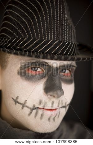 Young Boy In Skull Makeup For Halloween