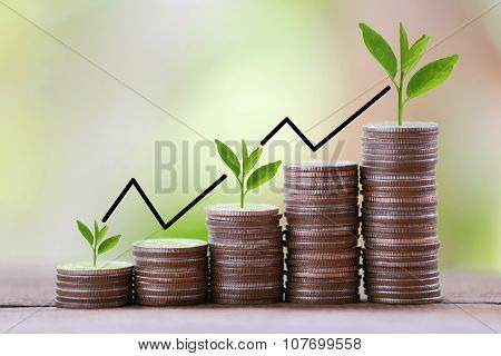 Silver Coin Stack And Arrow Line In Business Growth Concept On Wood Floor With Colorful Nature Backg