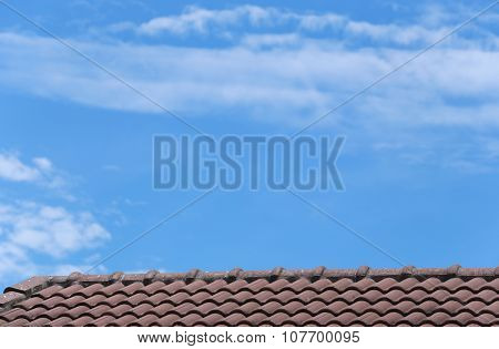 House Roof And Blue Sky.