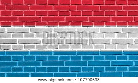 Flag of Luxembourg painted on brick wall