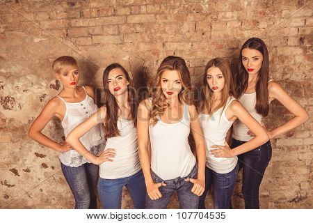 Confident Young Women With Red Lips Wearing A Dress Code