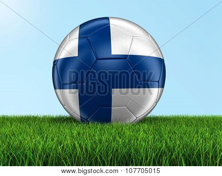 Soccer football with Finnish flag on grass