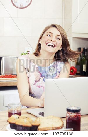 Happy girl using a computer