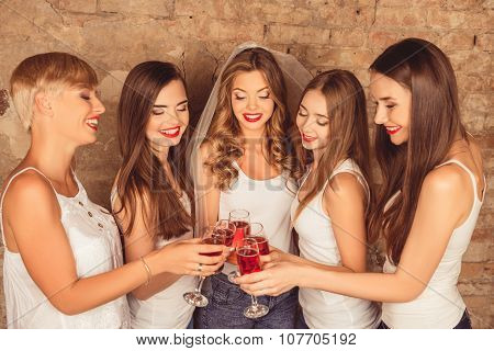Cute Bride And Happy Bridesmaids Celebrating Hen-party With Red Champagne