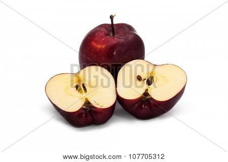 One and a half dark red apples over white background