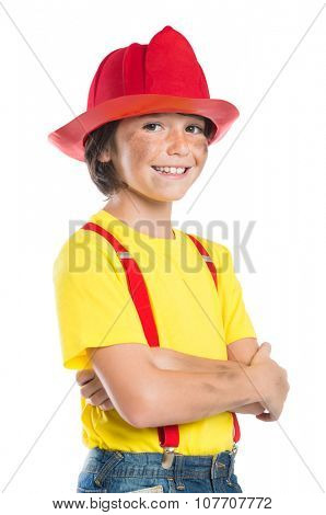 Closeup of smiling boy wearing firefighter helmet isolated on white background. Happy little fireman looking at camera with armcrossed.