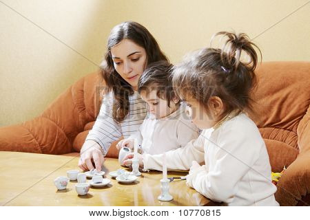 Mummy Playing With Daughters At Home
