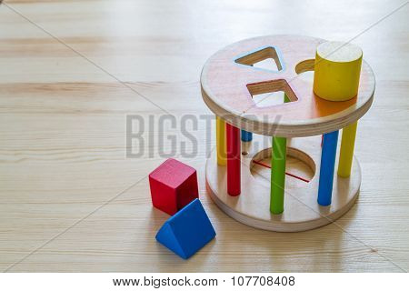 Sorter toy on wood background