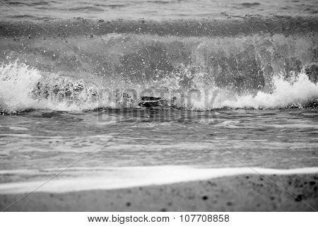 Wave breaking on beach