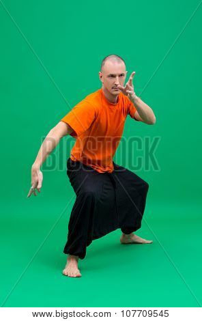 Image of middle-aged yogi doing asana