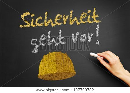 Hand writing the German slogan