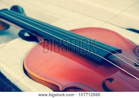 Closeup of a beautiful violin in a case.