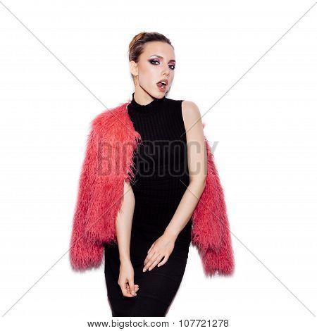 Fashion Girl Wearing Black Dress And Pink Fur Coat