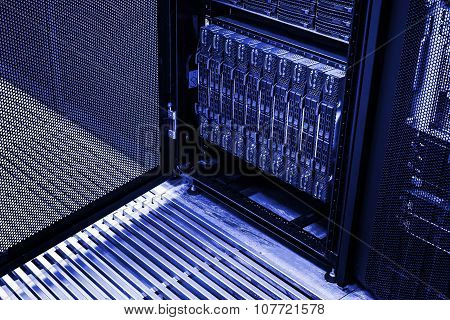 cluster of hard drives in a data center rack